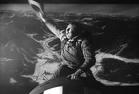 Screen capture of Major Kong riding on top of a bomb falling from a plane in the film, Doctor Stangelove.